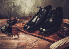 Shoe care accessories on a wooden table Stock Photos
