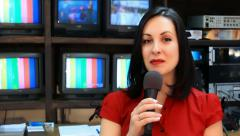TV reporter in front of the studio camera - stock footage