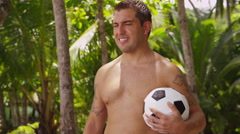 Portriat of man at beach with soccer ball, Costa Rica Stock Footage