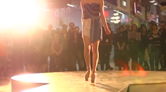 Fashion show young model thin slender legs on a catwalk Stock Footage