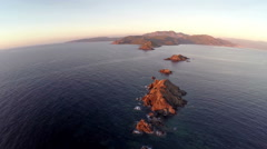 Flight over the sea and islands at sunset, Ajaccio area, Corsica. Aerial view. Stock Footage