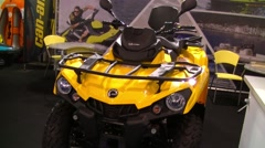Yellow ATV on  fishing and hunting  fair Stock Footage