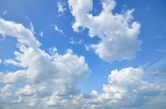 White Cumulus Clouds In The Sky - stock photo
