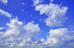 White Cumulus Clouds In The Sky Stock Photos