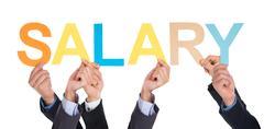 Many Hands Holding The Word Salary - stock photo