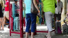 Shoppers Look at Merchandise Outside a Store Stock Footage
