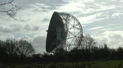 Radio telescope jodrell bank side view silhouette moving clouds Stock Footage
