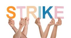 Stock Photo of Close-up Of Hands Holding The Word Strike Over White Background
