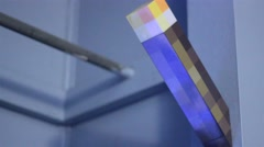 Minecraft torch toy on blue wall Stock Footage