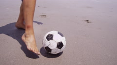 Man kicking soccer ball at beach, Costa Rica - stock footage