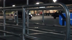 Shopping cart in parking lot at night Stock Footage