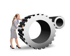 busy businesswoman pushing cogwheel - stock illustration