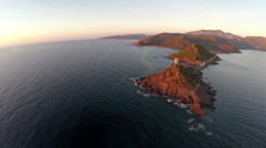 Flight over the sea and islands at sunset. Corsica, France. Aerial view. Stock Footage