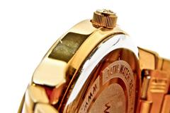 Golden wrist watch - stock photo