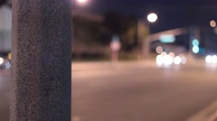 Street light pole in front of street at night Stock Footage
