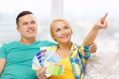 Couple looking at color samples in new home Stock Photos