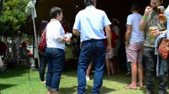 Stock Video Footage of People Wait in a Queue to get Beer at Clarens Craft Beer Festival