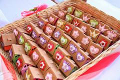Basket with packed sweets - stock photo