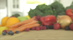 Pan of Out of Focus Produce Ends on a Green Apple (2 of 2) Stock Footage