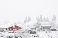 Houses in La Arboleda with snowstorm Stock Photos