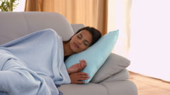 Woman napping on her couch - stock footage