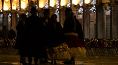 Group of costumed people at night Stock Footage