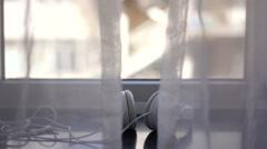 Earphone on the sunny window sill Stock Footage