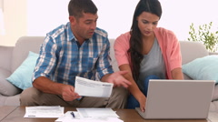 Couple working out their bills Stock Footage