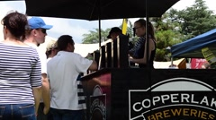 Bartenders Serve People at the Clarens Craft Beer Festival Stock Footage