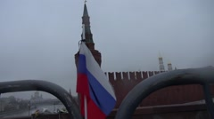 Funeral Russian flag with a black ribbon at the Kremlin on the site of the Stock Footage