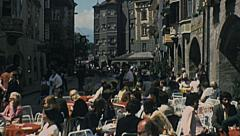 Innsbruck 1976: people relaxing in an outdoor bar Stock Footage