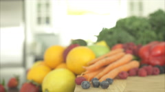 Pan of Out of Focus Produce Ends on an Orange (2 of 2) - stock footage