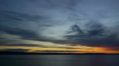 Sunset at calm sea and cloudy sky Stock Footage