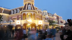 People move near castle in Disneyland at evening. Stock Footage