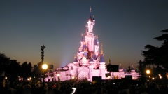 People watch the evening show about pink castle at Disneyland - stock footage