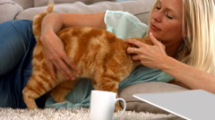 Happy blonde with her cat Stock Footage