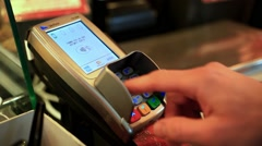 Close-up of human hand holding plastic card in payment machine. HD. 1920x1080 Stock Footage