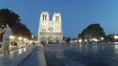 People on square near Notre-Dame Cathedral, Paris. Stock Footage