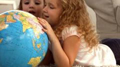 Stock Video Footage of Cute siblings looking at globe