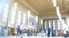 People move at hall of station, view from the corner. Stock Footage