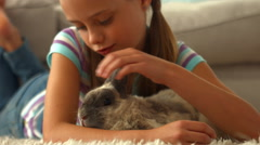Happy girl with pet rabbit Stock Footage