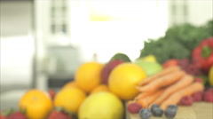 Pan of Out of Focus Produce Ends on a Yellow Onion (2 of 2) - stock footage