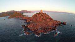 Flight and takeoff over old tower in the sea, Corsica. Aerial view. Stock Footage