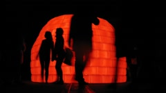 People walk around a glowing ice house on The RUSSIA Stock Footage