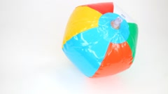 Ball inflates, spinning and deflates on white. Stop motion. Stock Footage