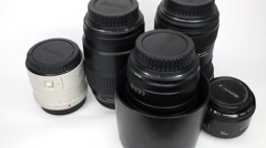 There are Canon lens model, turn, move and disappear on white. Stock Footage