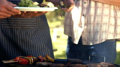 Happy family having barbecue in the park Stock Footage