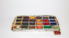 Dirty box with watercolors, out of box laid out boxes with paints Stock Footage