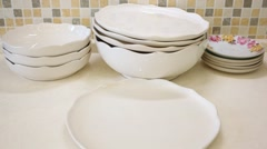 There are plates, bowls, arranged in a stack, move and twist Stock Footage