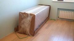 Sofa unpacked and folded in an empty room. Stop motion. Stock Footage